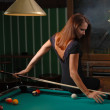 Girl playing billiards — Stock Photo