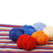 Close-up of colored clews on knitted cloth. — Stock Photo