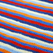 Striped diagonal background of knitted cloth. — Stock Photo
