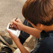 Boy playing with gadget  — Stockfoto