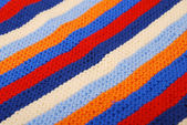 Close-up of striped diagonal knitted cloth. — Stock Photo