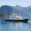 Ferry on blue water of Norwegian fjord. — Stock Photo #35131899