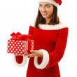 Merry Santa offering a christmas present. — Stock Photo