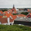 Red tile roofs of european town. — Stock Photo