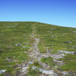 Green hill with path in the sky. — Stock Photo