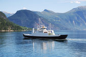 Ferry on blue water of Norwegian fjord. — Stock Photo