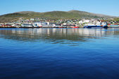 Blue water of fjord against the northernmost city Hammerfest. — Stock Photo