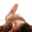 Lying woman in the dappled catsuit — Stock Photo