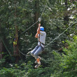 Teenage boy zipping down — Stock Photo