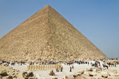 Tourists at the foot of an Egyptian pyramid — Stock Photo