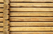 Wood wall of a loghouse — Stock Photo