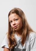 Portrait of the ironical preteen girl — Stock Photo