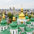 Ancient cathedral against the modern city Kyiv — Stock Photo #37424973