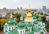 Ancient cathedral against the modern city Kyiv — Stock Photo
