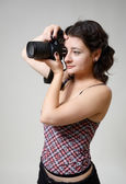Young woman photographing — Stock Photo