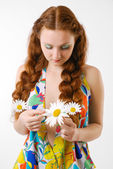 Sad girl telling fortunes by the camomile — Stock Photo
