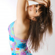 Girl bending in the florald dress, side view. — Stock Photo