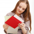 Teenage girl reading cards. — Stock Photo