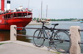 Pier with a bike and red steamship in Helsinki — Stock Photo