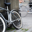 Stock Photo: Abandoned bicycle against blurred cycle traffic
