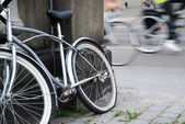 Abandoned bicycle against blurred cycle traffic — Stock Photo