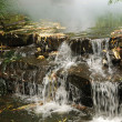 Stock Photo: Close-up of small artificial waterfall