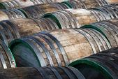 Wine oak barrels lying — Stock Photo