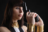 Close-up of woman in manacles with a handgun. — Stock Photo