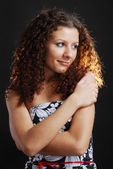 Frizzy woman with cross arms — Stock Photo