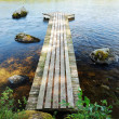 Wooden footway on lake — Stock Photo #40341175