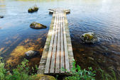 Wooden footway on the lake — Stock Photo