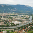 Stock Photo: View of Grenoble with river and mountains.