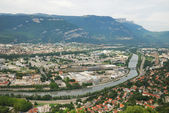 View of Grenoble with the river and mountains. — Stock Photo