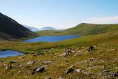 Blue lakes on the green hills of Soroya. — Photo