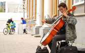 Street musician with violoncello. — Stock Photo