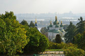 Orthodox church in the autumn park. — Stock Photo