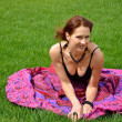 Young woman resting on the grass plot — Stock fotografie