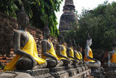 Row of Buddha sculptures in thai temple — Stock Photo