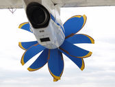 Engine with airscrew under wing of airplane, rear view — Stock Photo