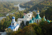 Winding river and religious buildings in the middle of forest, Ukraine — Stock Photo