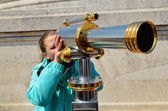 Girl with a big spyglass — Stok fotoğraf