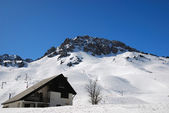 House near snowed peak in Pyrenees — Stock Photo