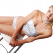 Sexy blond girl on the high chair — Stock Photo #48290933