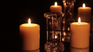 Hourglass and candle — Vídeo de Stock
