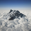 Mountain peak over the clouds — Stock Photo