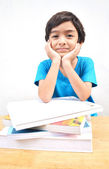 Little boy studying text books — Stock Photo