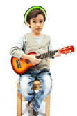 Little boy pretending a musician with ukulele — Stock Photo