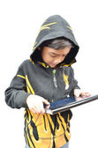 Little boy portrait play tablet fire jacket on white background — Stock Photo