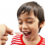 Little boy drinking syrup medicine liquid — Stock Photo