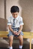 Sad studen lonely at school — Stock Photo